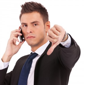 businessman-thumbs-down-angry-suit-cell-phone-iPhone-300x300